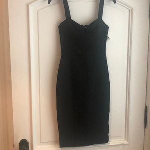 Fitted black knee length dress